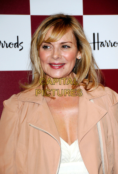 KIM CATTRALL .Harrods Summer Sale, Knightsbridge, London, England. .June 30th, 2008 .headshot portrait pink peach cream beige jacket .CAP/CAN.©Can Nguyen/Capital Pictures.