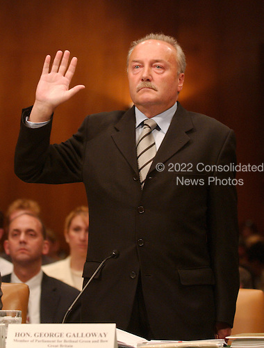 "Washington, D.C. - May 17, 2005 -- George Galloway , Member of Parliament for Bethnal Green and Bow, Great Britain, is sworn-in to testify before the United States Senate Committee on Homeland Security and Governmental Affairs Permanent Subcommittee on Investigations hearing on ""Oil For Influence: How Saddam Used Oil to Reward Politicians Under the United Nations Oil-for-Food Program"" in Washington, D.C. on May 17, 2005.  .Credit: Ron Sachs / CNP"