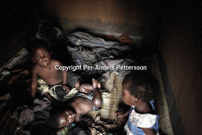GALUFU, MALAWI NOVEMBER 16: Unidentified Aids orphans wake up in a hut on November 16, 2005 in Galufu, Malawi. The village has about 378 orphans out of a population of about 1400. The village has seen an increase in poverty the last few years due to drought and HIV/Aids. Southern Africa has been hit by a severe hunger crisis due to drought and poverty. An ever-increasing HIV/Aids rate adds to the misery. Malawi is one of the worst hit areas and Galufu village is a typical small village that has become victim of this poverty spiral. <br /> (Photo by Per-Anders Pettersson)
