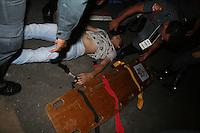 ATENÇÃO EDITOR: FOTO EMBARGADA PARA VEÍCULOS INTERNACIONAIS. - SÃO PAULO - SP -  31 DE DEZEMBRO 2012.REVEILLON NA PAULISTA. - Rapaz e atendido por bombeiros apos passar mau na Avenida Paulista, durante a festa Reveillon 2013. FOTO: MAURICIO CAMARGO / BRAZIL PHOTO PRESS.