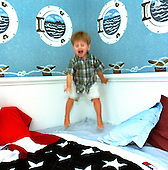 Two year old Cody Brendle who has been blind since birth, has fun jumping on his bed in his home in South Brunswick on Tuesday June 26, 2001. photo by jane therese
