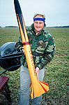 A rocketeer shows of his homemade  rocket launch at an amateur rocket festival..Manchester, Tennessee. USA.