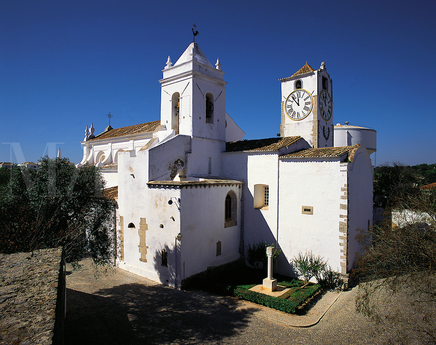 Very traditional stone-built church with twin square towers in the town of Tavira, Algarve, Portuga