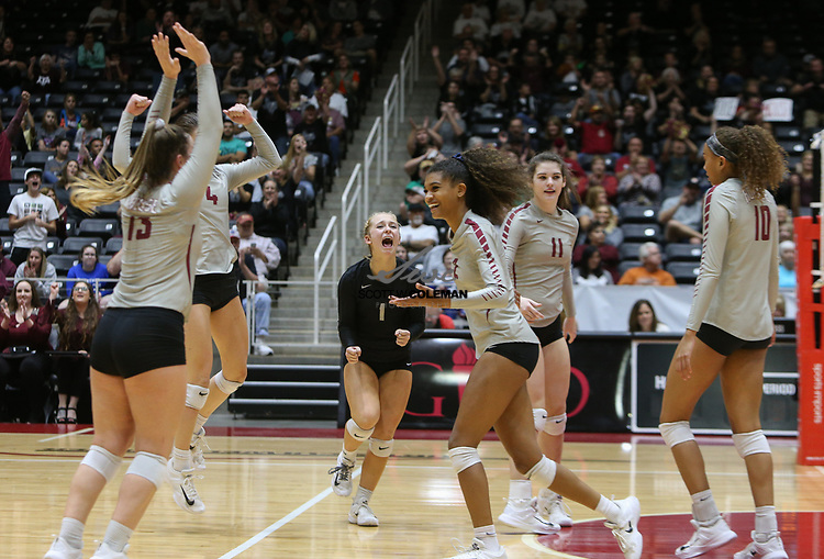The Rouse Raiders celebrate winning the third set of a Class 5A girls high school semifinal volleyball game between Rouse High School and Aledo High School at Curtis Culwell Center in Garland, Texas, on November 17, 2017, sweeping Aledo (25-17, 27-25, 25-18) to advance to the finals.