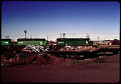 R.R. yards with 3 Burlington Northern diesels #7106, #6346, #6917 possibly Alamosa.<br /> D&amp;RGW