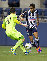 CF Monterrey forward Sergio Santana, right, changes direction against Seattle Sounders FC defender Zach Scott during a CONCACAF Champions League match at CenturyLink Field in Seattle Tuesday Oct. 18, 2011. CF Monterrey won the game 2-1.