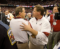 Alabama head coach Nick Saban hugs with Alabama offensive coordinator Jim McElwain after winning BCS National Championship game against LSU at Mercedes-Benz Superdome in New Orleans, Louisiana on January 9th, 2012.   Alabama defeated LSU, 21-0.