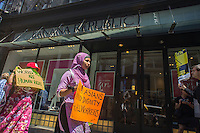 Hundreds of workers and supporters march through the streets of Soho on Saturday, June 29, 2013 stopping off at various clothing retailers including the Gap's Banana Republic, protesting the companies' refusal to the Bangladesh Safety Accord guaranteeing better safety conditions in Bangladeshi factories. In April a collapse of an enormous garment factory killed over 1000 workers. (© Richard B. Levine)