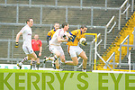 Duagh's Anthony Maher being tackled by Dromid Tomas Curran during their Junior C'ship final in Fitzgerald Stadium on Sunday