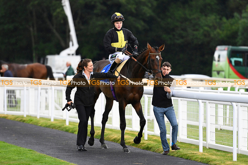 Swashbuckle ridden by Joshua Bryan and trained by Andrew Balding is led into the winners enclosure after winning The H S Lester Memorial Handicap, during Whitsbury Manor Stud Bibury Cup Day Racing at Salisbury Racecourse on 28th June 2017
