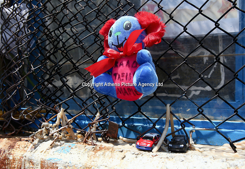 """Pictured: A soft toy with the words (Farewell Marios) and other toys are left at the gate of the 6th primary School in Acharnes, Athens, Greece. Saturday 10 June 2017<br /> Re: An 11 year old boy has been shot dead by a """"stray bullet"""" during a school celebration in Acharnes (Menidi) area, in the outskirts of Athens, Greece.<br /> Marios Dimitrios Souloukos """"complained to his mum"""" who works as a teacher at the 6th Primary School of Acharnes that he was feeling unwell, he then collapsed with blood pouring out from the top of his head.<br /> His mum tried to revive him assisted by other teachers while his schoolmates who were reportedly upset, were hurriedly removed by their parents.<br /> According to locals an ambulance arrived 25 minutes late.<br /> Hundreds of police officers have been deployed in the area and have raided many properties.<br /> Shells matching the fatal bullet which hit the boy on the top of his head were found in a house yard nearby.<br /> Local people reported hearing shots being fired at a nearby Romany Gypsy camp before the fatal incident.<br /> The area has been plagued with criminality during the last few years."""