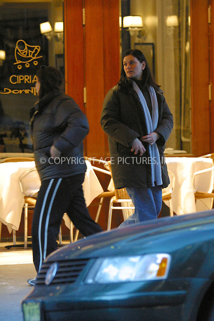 ***EXCLUSIVE***..Actress Linda Fiorentino and unidentified friend exit Cipriani Downtown restaurant on West Broadway after they had late lunch or early dinner at about 4:30pm. New York, December 18, 2002. Please byline: Alecsey Boldeskul/NY Photo Press.   ..*PAY-PER-USE*      ....NY Photo Press:  ..phone (646) 267-6913;   ..e-mail: info@nyphotopress.com