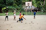 PHILIPPINES, Palawan, Barangay region, Batak boys play with their hand made toys in Kalakwasan Village