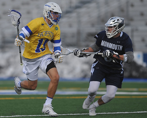 Dominic Pryor #19 of Hofstra University, left, gets pressured by Grier Wilson #6 of Monmouth during the second quarter of an NCAA men's lacrosse game at Shuart Stadium in Hempstead, NY on Wednesday, March 14, 2018. Hofstra won by a score of 7-6.