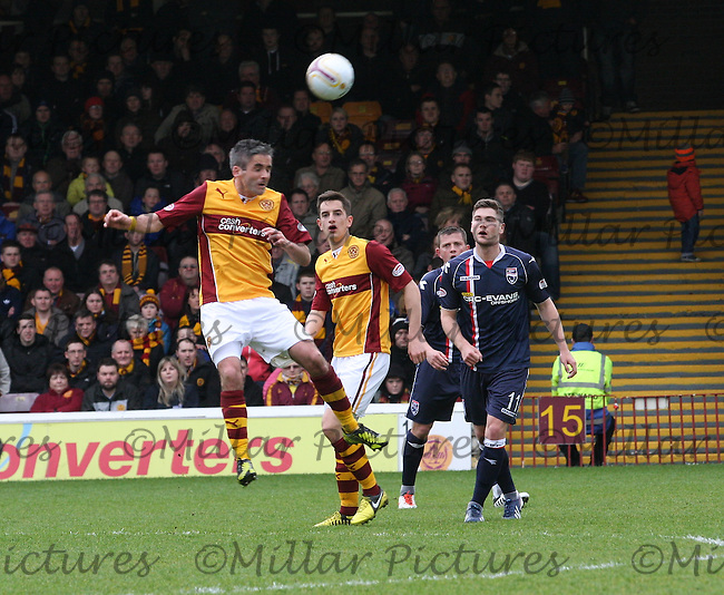 Keith Lasley heading watched by (left to right) Simon Ramsden, Richard Brittain and Iain Vigurs  in the Motherwell v Ross County, Clydesdale Bank Scottish Premier League match at Fir Park, Motherwell on 12.5.13.