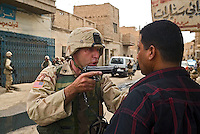 "Baghdad, Iraq, June 2, 2003.US troops often completely misunderstand perfectly benign circumstances for lack of translators and proper training, creating potentially dangerous situations for the Iraqi population they are supposed to protect. Here, a couple of gunshots were fired in the air at the end of a wedding as is customary, US troops patrolling the area blocked up a street and tried to break into a house where they wrongly thought the ""shooter"" had taken refuge, the man being arrested and quite brutally treated, is in fact the owner of the house who keenly offered to open it to prove it was empty..."