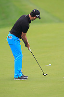 Fabrizio Zanotti (PAR) putts on the 3rd green during Thursday's Round 1 of the 2014 BMW Masters held at Lake Malaren, Shanghai, China 30th October 2014.<br /> Picture: Eoin Clarke www.golffile.ie