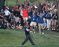 Z.Open.14.0614.jl.jpg/photo Jamie Scott Lytle/Tiger Woods reacts as do the fans after sinking a put on the 13th green at the US Open Saturday