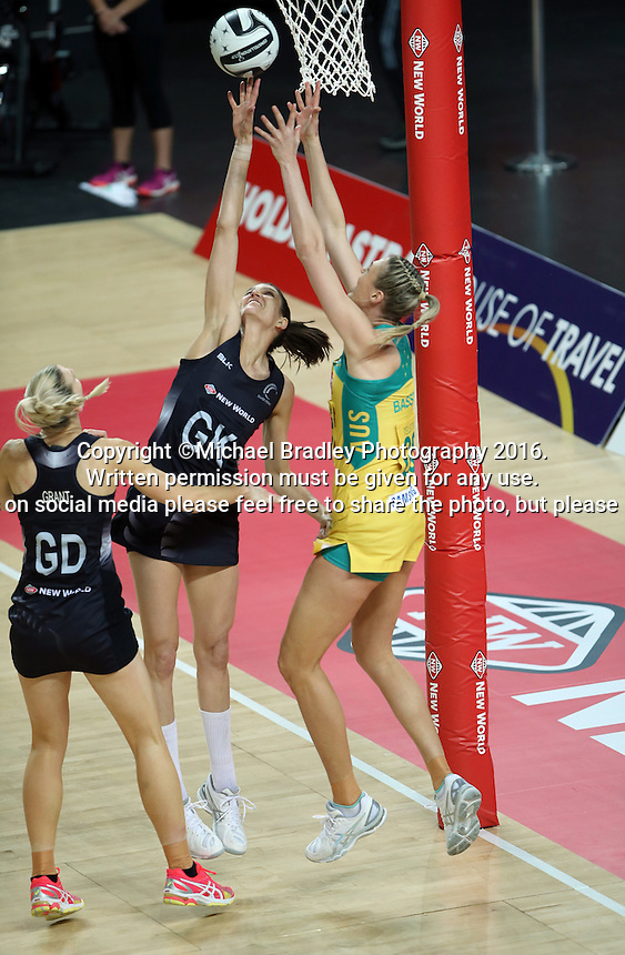 15.10.2016 Silver Ferns Anna Harrison and Australia's Caitlin Bassett in action during the Silver Ferns v Australia netball test match played at Vector Arena in Auckland. Mandatory Photo Credit ©Michael Bradley.