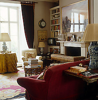 Light floods in to the traditional drawing room through floor-to-ceilng French windows