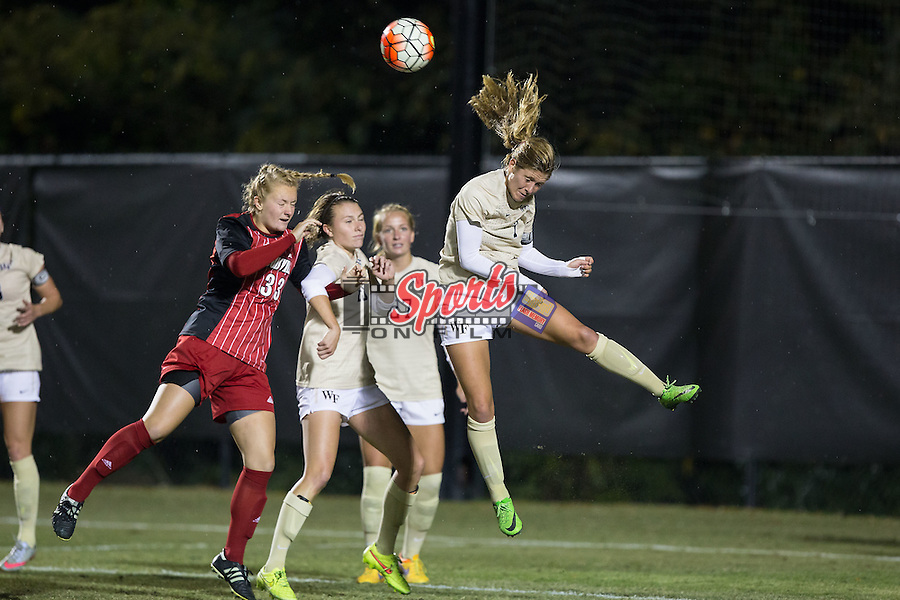 Sarah Teegarden (7) of the Wake Forest Demon Deacons heads the ball out of the box on a Louisville Cardinals corner kick late in the second half of play at Spry Soccer Stadium on October 31, 2015 in Winston-Salem, North Carolina.  The Demon Deacons defeated the Cardinals 2-1.  (Brian Westerholt/Sports On Film)