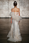 Model walks runway in a VIP feather strapless fully sequined tulle mermaid with tulle feather accents, from Inbal Dror Fall 2018 bridal collection on October 5, 2017; during New York Bridal Fashion Week.