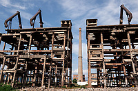 Albania. Elbasan. Derelict buildings and chimney of a factory.The factory stopped functioning at the fall of the communist system. Elbasan is a city and a municipality in Elbasan County, central Albania. 20.05.2018 © 2018 Didier Ruef