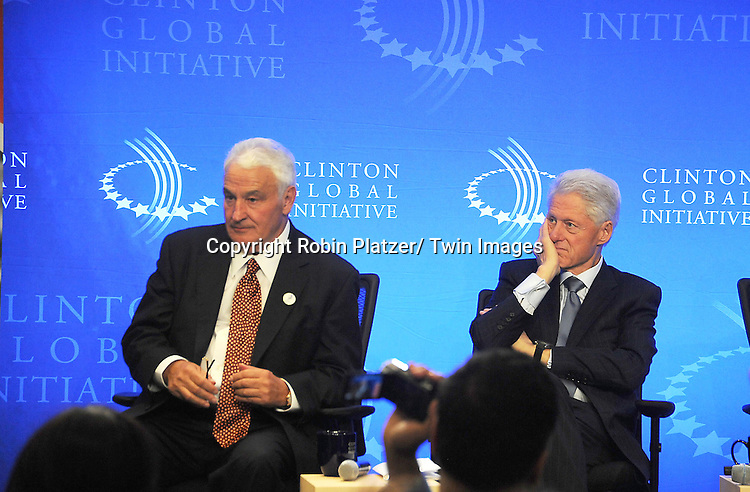 Tom Golisano and President Bill Clinton speaks at the Press Conference at the Clinton Global Initiative focusing on the  Special Olympics to announce funding to expand Health Services Worldwide on September 23, 2012 at The Sheraton Hotel in New York City.