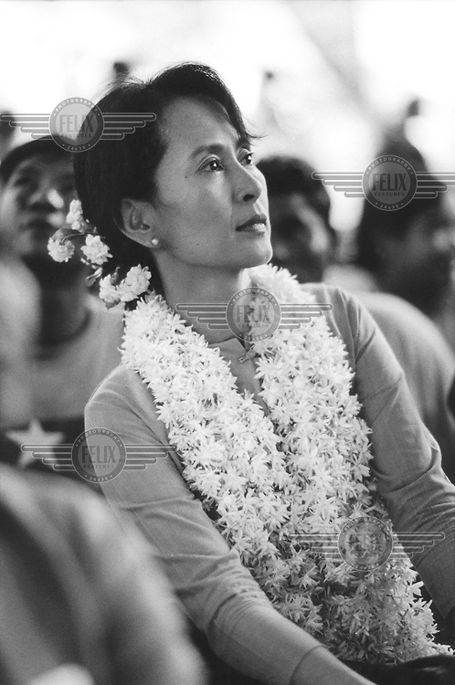 © Dean Chapman / Panos Pictures..Rangoon, BURMA..Daw Aung San Suu Kyi watching performers at the celebrations for Burmese New Year, held in the compound of her family home.