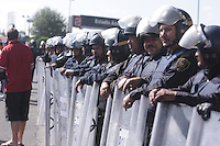 A line of Mexican police officers escorts United States fans out of Azteca Stadium. Mexican police officers in riot gear separated the team's fan supporters to prevent any violence. The United States Men's National Team played Mexico in a CONCACAF World Cup Qualifier match at Azteca Stadium in, Mexico City, Mexico on Wednesday, August 12, 2009.
