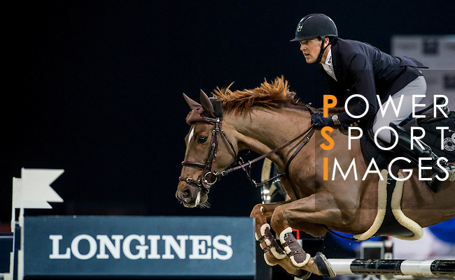 Simon Delestre of France rides Ryan des Hayattes in action during the Longines Grand Prix as part of the Longines Hong Kong Masters on 15 February 2015, at the Asia World Expo, outskirts Hong Kong, China. Photo by Victor Fraile / Power Sport Images