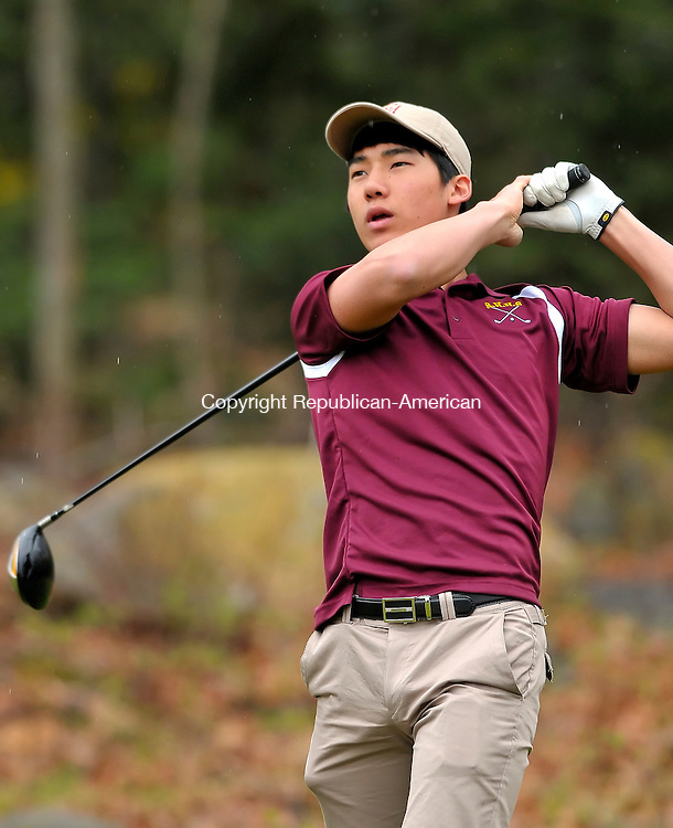 WATERBURY, CT-09 APRIL 2010-040910JS01-Sacred Heart's Ryan Kim watches his shot as he tees off on three during their match against Torrington Friday at East Mountian Golf Course in Waterbury. <br /> Jim Shannon Republican-American