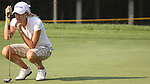 Jennifer Ackerson awaits her turn before putting the ball on the 9th hole during Alliance Bank Classic Golf in Syracuse; NY.