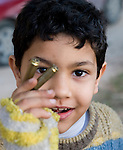 A SMALL BOY, EXCITED TO SHOW BULLETS.. BENGHAZI, LIBYA..19-3-2011 PIC BY IAN MCILGORM