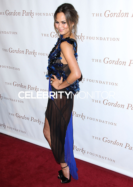 NEW YORK CITY, NY, USA - JUNE 03: Model Chrissy Teigen arrives at the 2014 Gordon Parks Foundation Awards Dinner & Auction held at Cipriani Wall Street on June 3, 2014 in New York City, New York, United States. (Photo by Jeffery Duran/Celebrity Monitor)