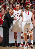 STANFORD, CA - December 29, 2012: Stanford Cardinal's Head Coach Tara VanDerveer with Joslyn Tinkle and Toni Kokenis during Stanford's 61-35 loss to Connecticut at Maples Pavilion in Stanford, California.