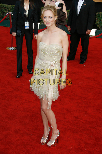 HEATHER GRAHAM.Red Carpet Arrivals - 13th Annual Screen Actors Guild (SAG) Awards, held at the Shrine Auditorium, Los Angeles, California, USA, 28 January 2007..full length strapless gold beaded dress silver platform shoes.CAP/ADM/RE.©Russ Elliot/AdMedia/Capital Pictures.