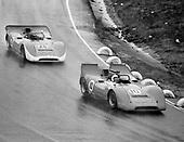 Chuck Parsons (no. 10) leads Skip Scott in the Haas Lola T160s through the rain in the 1968 Laguna Seca Can-Am.