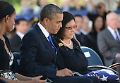 President Barack Obama and First Lady Michelle Obama comfort Irene Hirano Inouye, wife of the late United States Senator Daniel Inouye (Democrat of Hawaii) during funeral services for the late Senator at the National Memorial Cemetery of the Pacific on Sunday, December 23, 2012.  Senator Inouye was a Medal of Honor recipient and a U.S. Senator since 1963.    .Credit: Cory Lum / Pool via CNP