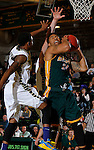 NOVEMBER 17, 2014 -- Yoshio Allen #24 of Black Hills State hauls in a rebound in front of Jaisean Jackson #5 of South Dakota Mines during their college men's basketball game Monday evening at the Donald E. Young Center in Spearfish, S.D.  (Photo by Dick Carlson/Inertia)