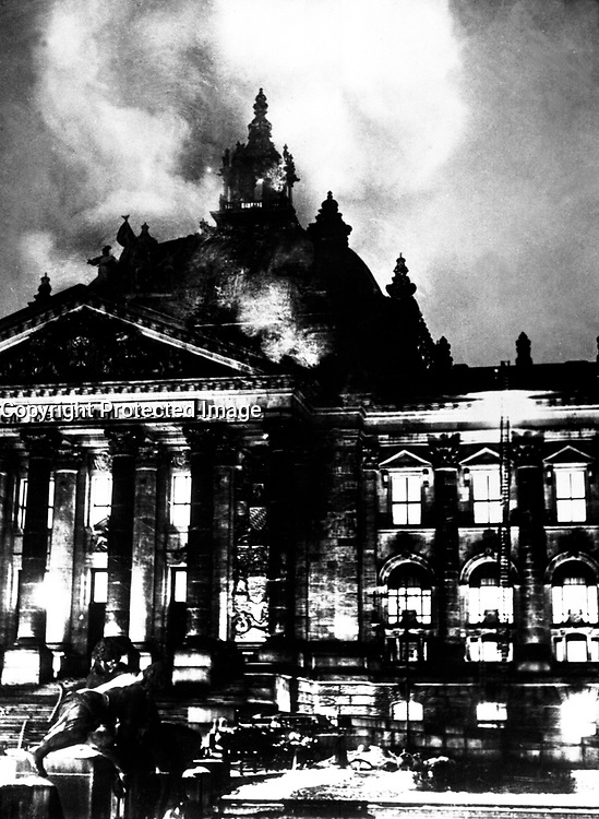 Firemen work on the burning Reichstag Building in February 1933, after fire broke out simultaneously at 20 places.  This enabled Hitler to seize power under the pretext of &quot;protecting&quot; the country from the menace to its security.  Berlin.  Acme.  (OWI)<br /> Exact Date Shot Unknown<br /> NARA FILE #:  208-N-39835<br /> WAR &amp; CONFLICT BOOK #:  987