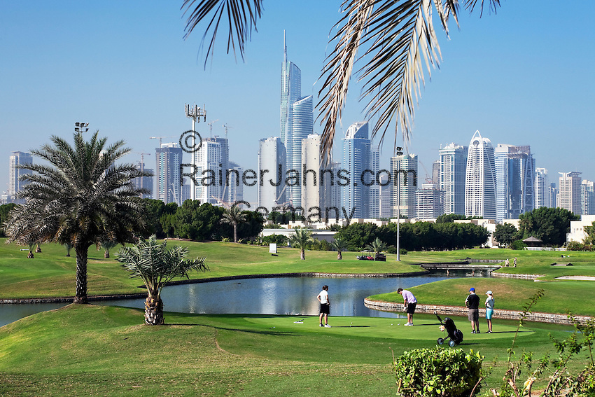 United Arab Emirates, Dubai: Emirates Hills, The Montgomerie Golf Club and skyline of Dubai Marina area