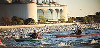 Swimmers pass in front of Monona Terrace during the Wisconsin Ironman on Sunday in Madison