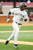 Kevin Jordan #21 of the Wake Forest Demon Deacons hustles down the first base line against the Elon Phoenix at Wake Forest Baseball Park on May 1, 2012 in Winston-Salem, North Carolina.  The Demon Deacons defeated the Phoenix 7-5.  (Brian Westerholt/Four Seam Images)