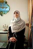 Nosayba Ashraf, 30 years old, is the Head of Research unit in the Foreign Relation comittee in FJP. Nosayba is part of the Muslim Brotherhood since she was 17; she has two children. Here she poses in Amal Abdel El-Karim's apartment in Doqqi district - Amal is in charge of the women section of FJP in Giza. Cairo, Egypt. October 2012.