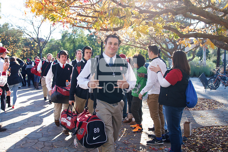 Stanford, CA - Saturday November 28, 2015: Family and friends greet the team before the Stanford vs Notre Dame game Saturday night at Stanford Stadium.<br /> <br /> The Cardinal defeated the Irish 38-36.