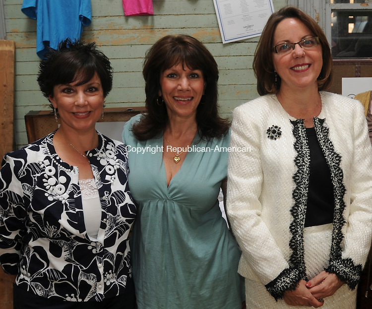THOMASTON, CT-01 MAY 2010-050110IP04- (l to r) Marisa Piccolo, and Mary Chiappalone and Lise Sanchez, both members of the St. Mary's Hospital Auxiliary, attended St. Mary's Hospital Auxiliary Clothes Express clothing drive launch at the New England Railroad Museum in Thomaston on Saturday. Clothes Express will replace clothing for patients who are brought to the emergency room and need the clothing cut off of them. The hospital recently lost its grant for this program.<br /> Irena Pastorello Republican-American
