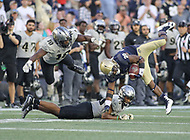 Annapolis, MD - October 21, 2017: Navy Midshipmen running back Darryl Bonner (29) is tackled during the game between UCF and Navy at  Navy-Marine Corps Memorial Stadium in Annapolis, MD.   (Photo by Elliott Brown/Media Images International)