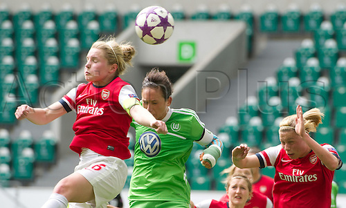21.04.2013. Wolfsburg, Germany. Womens Champions League, Wolfsburg versus Arsenal, second leg.  Wolfsburg's Nadine Kessler (2-L) and Arsenal's  Kim Little (L) and Gilly Flaherty (R) challenge for the ball during the match