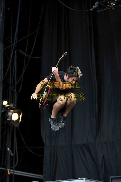 Jack Barakat of All Time Low.performing on Day 3 at Reading Festival, Reading, England. .26th August 2012.on stage in concert live gig performance performing music full length black t-shirt shorts guitar jump jumping gesture .CAP/MAR.© Martin Harris/Capital Pictures.